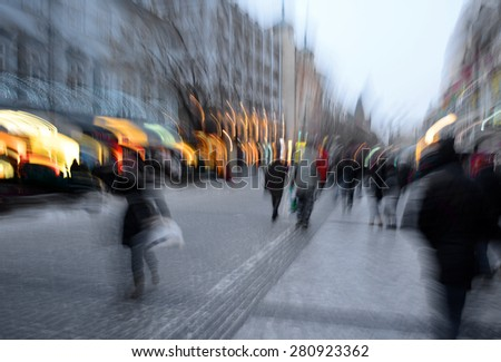 Busy city people going along the street. Intentional motion blur