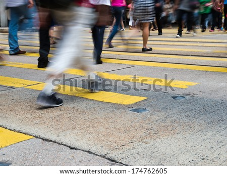 Busy city people on zebra crossing street in Hong Kong, China.