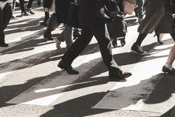 Busy city, people on zebra crossing street,vintage filter.