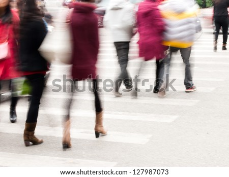 Busy city street people on zebra crossing