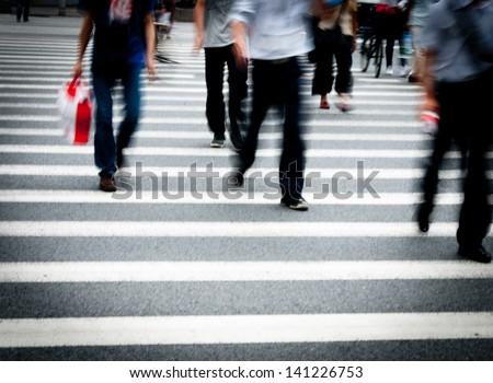 Busy city street people on zebra crossing