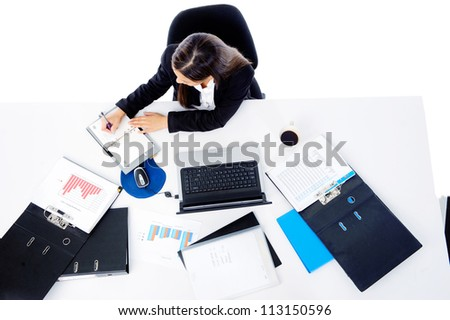 Busy corporate businesswoman entrepreneur working at her desk isolated on white background