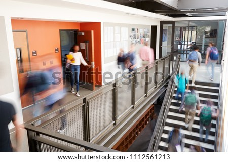 Busy High School Corridor During Recess With Blurred Students And Staff #1112561213