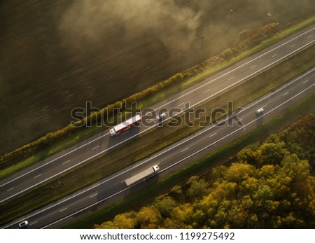 Busy highway. Trucks on highway, aerial photo #1199275492