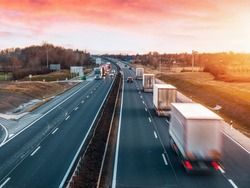 Busy highway with fast moving vehicles in beautiful sunset in Hungary