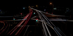 Busy intersection at night. Light trails left by cars. Car lights trailing through the night. Cars going through an intersection. Lights at night. A photo of an intersection in Western Australia.