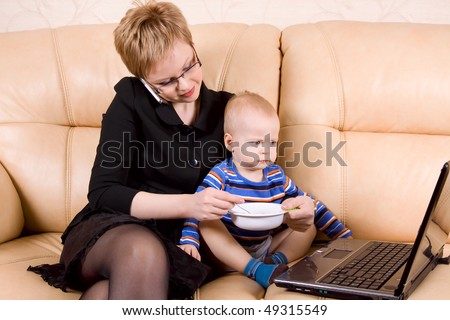 busy mom with little son