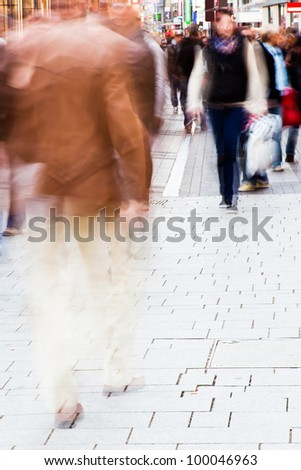 busy people walking in the city