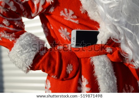 Busy Santa Claus using mobile device, closeup on hands