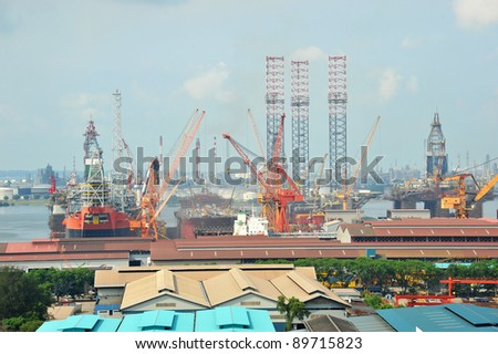 Busy Ship Repair Yard With Cranes