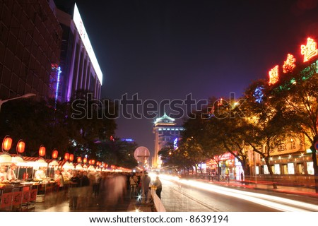 Busy street in Beijing with people at the nighttime food markets