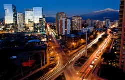 Busy traffic in Santiago, Chile with the Andes in the background