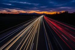 busy traffic on highway at sunset time.  light trace