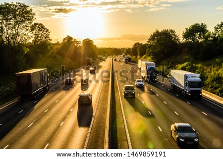 busy traffic on uk motorway road overhead view at sunset #1469859191