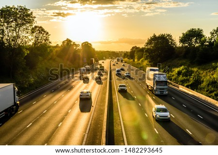 busy traffic on uk motorway road overhead view at sunset #1482293645