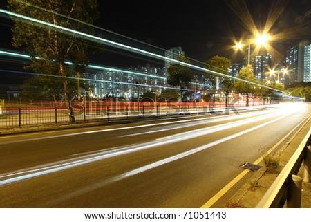 Busy traffic through downtown of Hong Kong at night