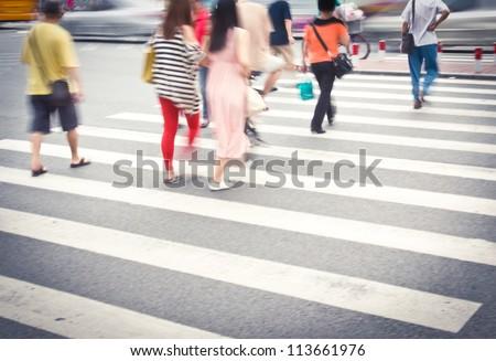 Busy urban street people on zebra crossing