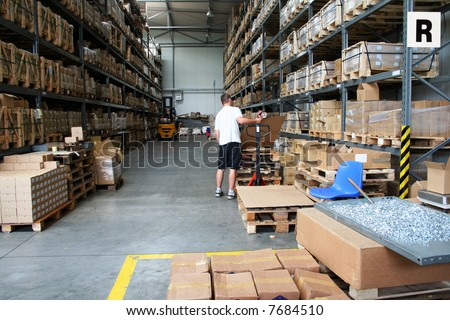 Busy warehouse with people working