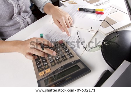 busy work, business woman calculating job on working day.