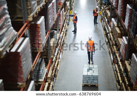 Busy workers inside storehouse of hypermarket