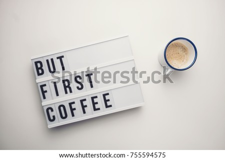 But First Coffee displayed on a vintage lightbox with coffee cup, concept image