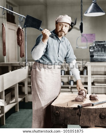 Butcher chopping meat with cleaver