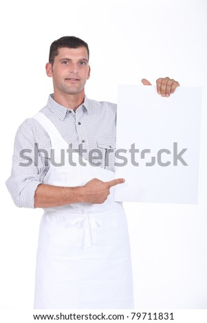 butcher showing a white panel - stock photo
