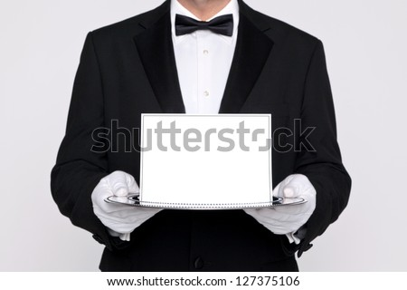 Butler holding a blank card upon a silver service tray, add your own message.