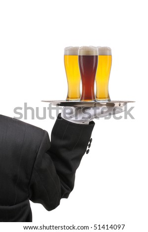 Butler in Tuxedo seen from behind with three beer glasses on serving tray held at shoulder height vertical format over white