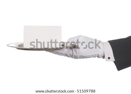 Butler or concierge hand holding silver tray and blank note. Horizontal format arm with hand outstretched from right side isolated on white.