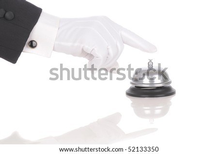 Butler's gloved hand extended over service bell isolated on white. Hand and arm only in horizontal format with reflections.