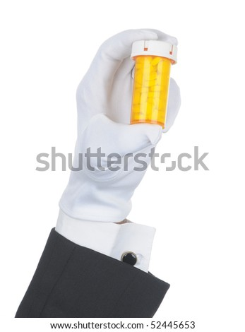 Butler's gloved hand holding prescription bottle filled with pills isolated over white. Hand and arm only in horizontal format.