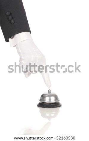 Butler's gloved hand with index finger over service bell isolated on white. Hand and arm only in vertical format with reflections.