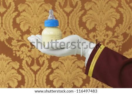 Butler's Hand with Bottle of Milk