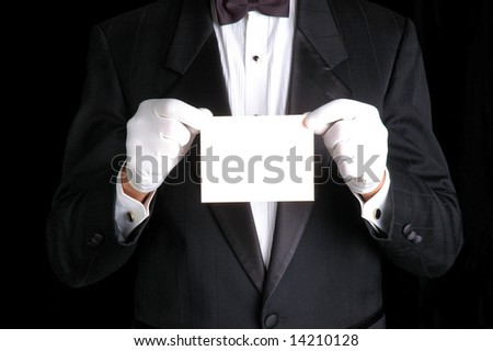 Butler Wearing a Tuxedo and Holding a Blank White Piece of Paper