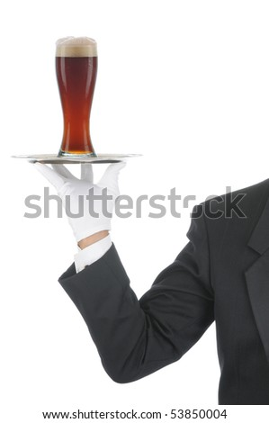 Butler wearing tuxedo and formal gloves holding a beer glass on a silver tray. Shoulder hand and arm only isolated on white vertical composition.