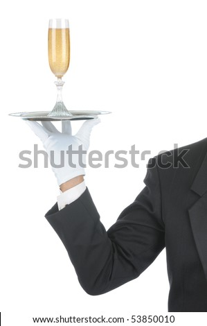 Butler wearing tuxedo and formal gloves holding a champagne glass on a silver tray. Shoulder hand and arm only isolated on white vertical composition.