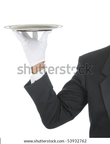 Butler wearing tuxedo and formal gloves holding a silver tray. Shoulder hand and arm only isolated on white vertical composition.