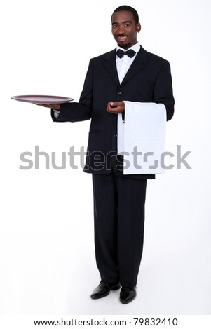 Butler with an empty tray - stock photo