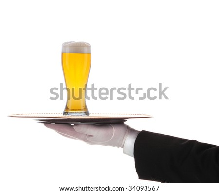 Butler with glass of  beer and tray on outstretched arm isolated over white