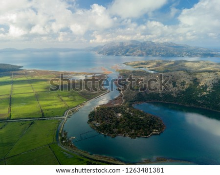 Butrint albania heritage site of UNESCO with corfu island greece in background. one of the best touristic locations for tourists coming by cruise ships in saranda albania  #1263481381