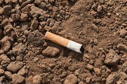 butt of a cigarette on ground