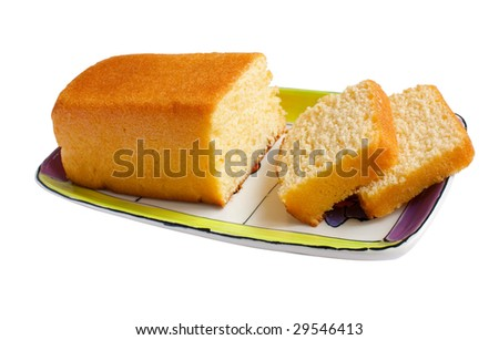 Butter cake and slices on plate isolated