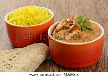 Butter Chicken & Lemon Rice - Indian butter chicken curry and lemon rice served with chapatis.