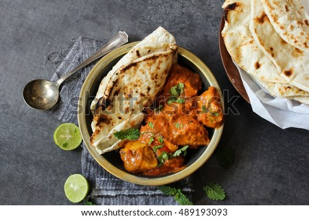 Butter chicken served with Homemade Indian Naan Bread / Murgh Makhani