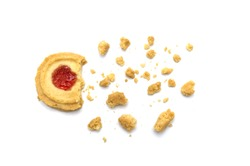 Butter cookies strawberry jam topping flavored. Some cracks and crumbs. Crunchy delicious sweet meal and useful biscuits on white background.