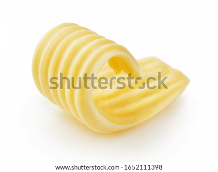 Butter curl or butter roll isolated on white background