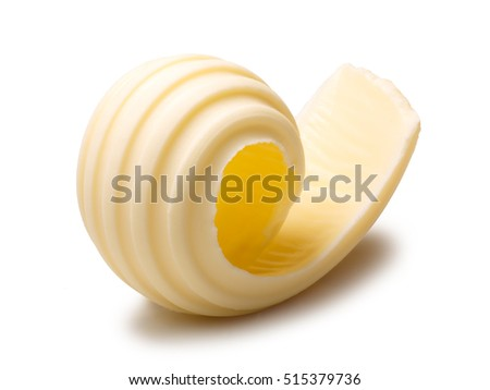 Butter curl or roll. Clipping paths, shadow separated