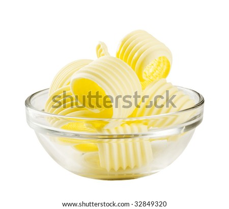 Butter curls in a glass bowl