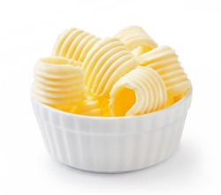 Butter curls or butter rolls in white bowl isolated on white background.
